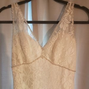 Ivory lace buttoned wedding dress Mori Lee